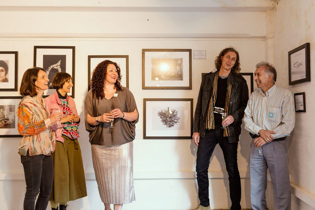 Chinking glasses with Caroline Gavazzi (category Environment winner), Sonia Hamza (category Identity winner), Laura Ann Noble (festival director) and Chris Steele Perkins (jury member and Magnum photographer)